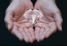 Diamond In Hands With Hand Reflections