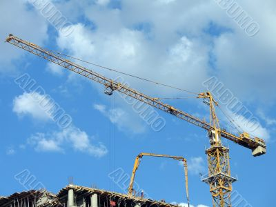 Yellow tower crane on a construction site