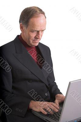 Business Man browsing on laptop