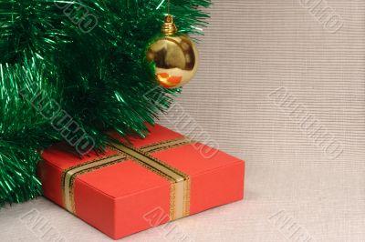 Gift box, ball and tinsel