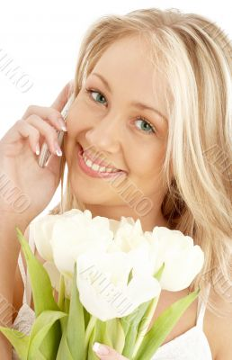 cheerful blond with white tulips and phone