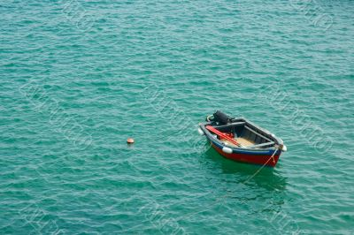 red fishing boat in green waters