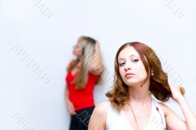Girl waiting when girlfriend correct hairstyle