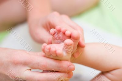 Mother hold baby leg together in your hand l#3