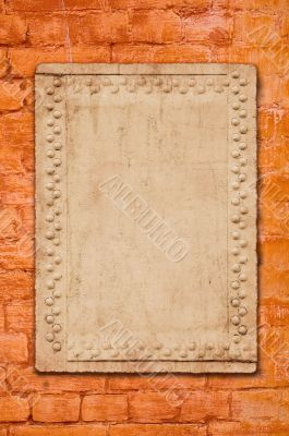 metal plate on brick wall - perfect grunge background