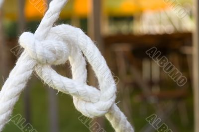 White Knot On Blurred Background