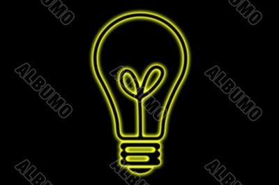 Yellow Glowing Light Bulb On A Black Background