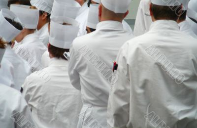 Group Of Chefs Standing In Uniform Whites