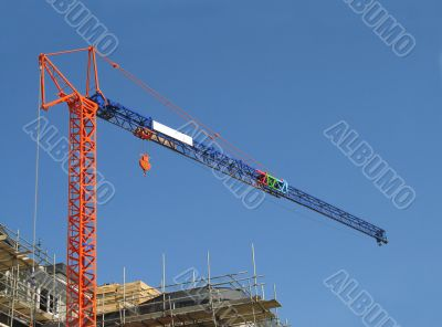 Orange and blue crane on construction site
