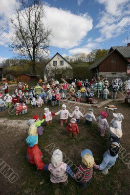 Rag dolls in village house yard under clouds