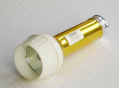 old gold coloured torch