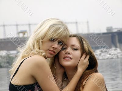 two embracing beautiful young girls 1