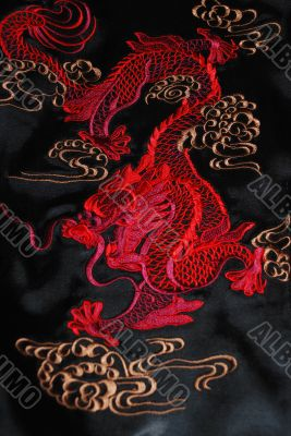 Red dragon on the black atlas