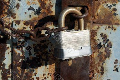 Iron lock and rusty chain
