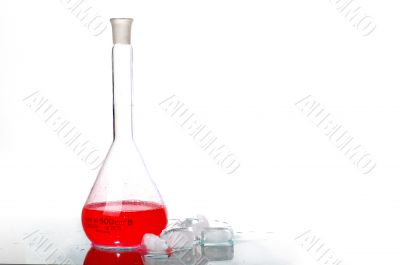 red liquid in Flask behind ice