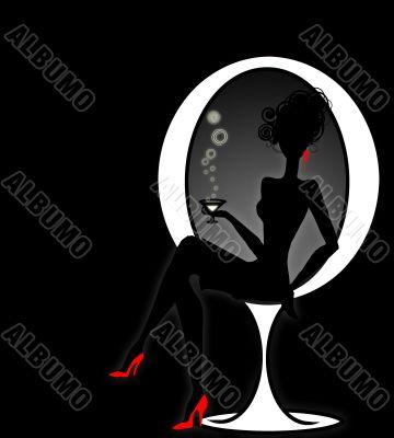 elegant  woman silhuette sitting on design chair