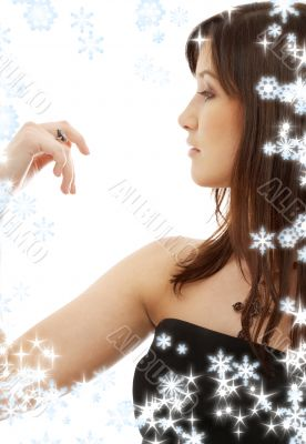 brunette with engagement ring and snowflakes