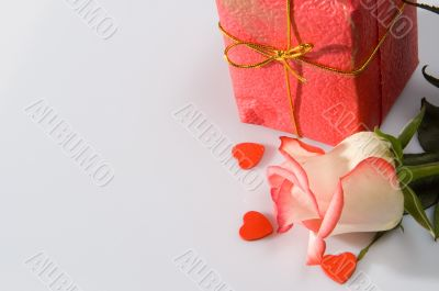 The rose and a present box