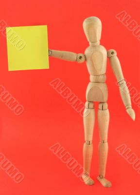 figure holding empty adhesive note