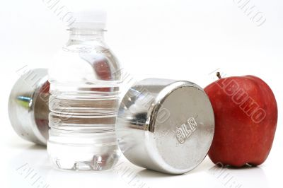 bottled water with fitness weight & apple