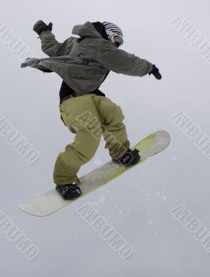 Jump of teens rap snowboarder over sky