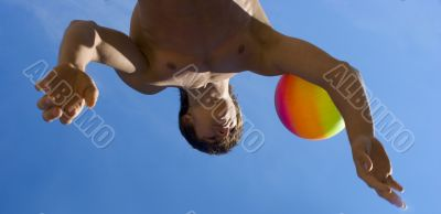 Sport build teenager with variegated ball