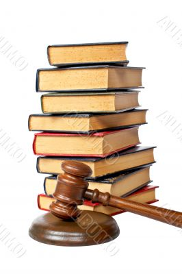 Wooden gavel and old law books