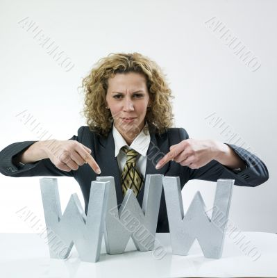 Woman showing three large letters www
