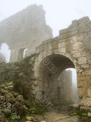 age-old stronghold gate arched mist morning