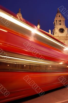 Blurred red London bus