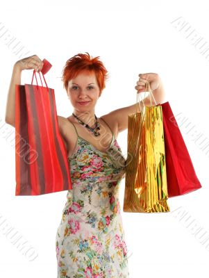 Shopping. Happy woman with different bags with purchases