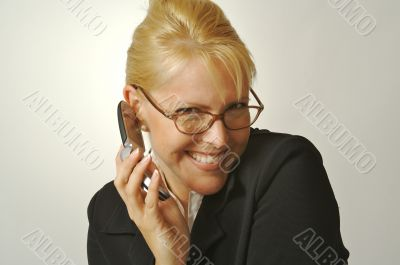 Elated Businesswoman Smiles While Using Her Cell Phone