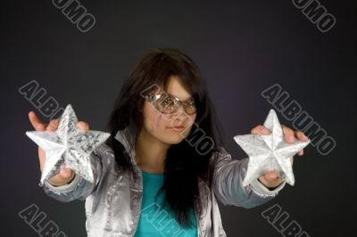 Fashion girl in silver jacket with two stars