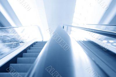 blurred escalator background