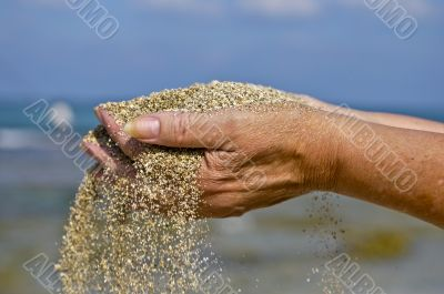 The sand through your fingers....
