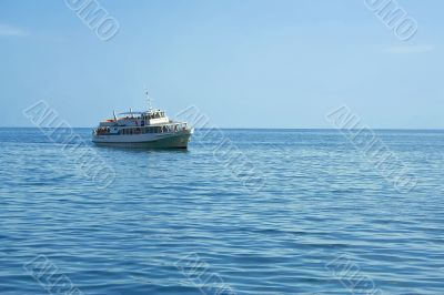 Pleasure boat at sea rolled tourists