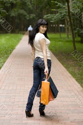 brunet girl with shopping bags