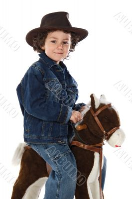 Child mounted on a wooden horse