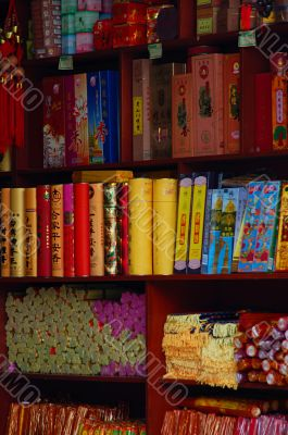 Aroma sticks on shelves in buddhist shop