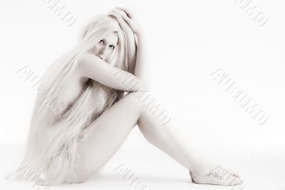 Long blond haired artistic beauty flirting with you