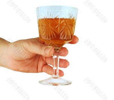 womanish hand holds crystal glass with wine