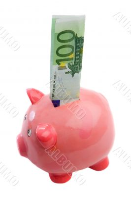 Note of one hundred of euros in a piggy-bank