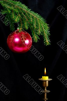 fir-tree  twig and red ball with candle