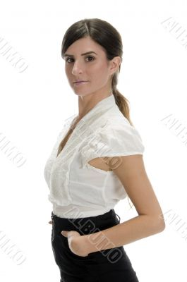 glamorous woman putting her hand in pocket