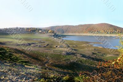 Empty reservoir Edersee in Germany with old ruins