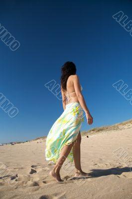 walking with beach wrap