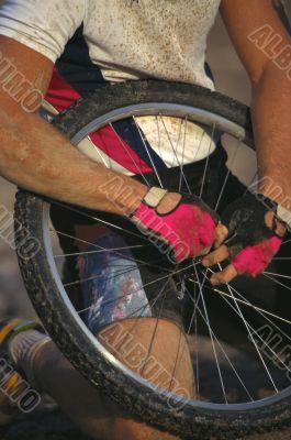 Man Hold Bike Tire