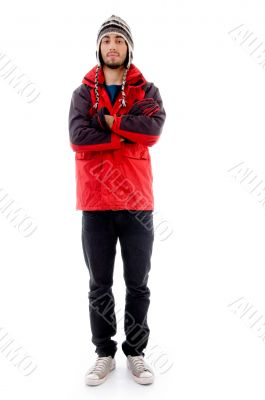 full body pose of young man in woolen cap