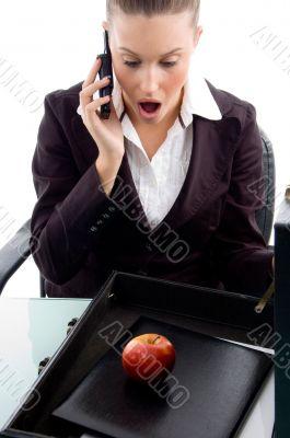 shocked professional talking on mobile