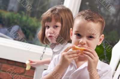 Sister and Brother Eating an Apple
